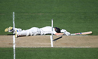 Henry Nicholls dives as he avoids being run out.<br /> New Zealand Blackcaps v England. 1st day/night test match. Eden Park, Auckland, New Zealand. Day 4, Sunday 25 March 2018. &copy; Copyright Photo: Andrew Cornaga / www.Photosport.nz