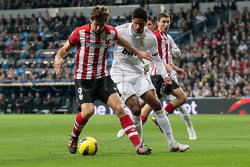 22.01.2012. Madrid Spain. La Liga  The match played between  Real Madrid and Athletic Club de Bilbao (4-1)  played at the Santiago Bernabeu Stadium.  Picture show Fernando Llorente Torres (Spanish forward of Athletic) and Raphael Varane (French defender of Real Madrid)