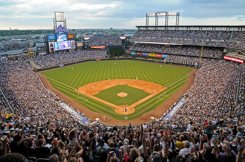 "01 JULY 2011:     A general view from high behind home plate as ""the wave"" makes its way around the stadium on a night with a sell out crowd before a fireworks show  during a regular season interleage game between the Kansas City Royals and the Colorado Rockies at Coors Field in Denver, Colorado. The Rockies beat the Royals 9-0.    *****For Editorial Use Only*****"