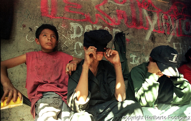 Street children gather around to sniff thinner under a  sewer in Mexico City's Central Park. Due to economic crisis and familiar violence, hundred of children leave their families and survive on streets. Photo by Heriberto Rodriguez