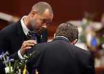 Senate Minority Leader Aaron Ford, D-Las Vegas, left, and Majority Leader Michael Roberson, R-Henderson, talk on the Senate floor at the Legislative Building in Carson City, Nev., on Thursday, Feb. 5, 2015. <br /> Photo by Cathleen Allison