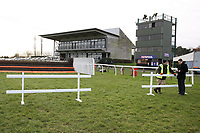 Two trestles are used to block off the fence by the finish line which was jumped by mistake at the last meeting - Horse Racing at Fakenham Racecourse, Norfolk