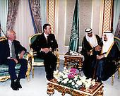King Fahd bin Abd al-Aziz al Saud of Saudi Arabia (right) is visited by United States Secretary of Defense William S. Cohen at his palace in Jeddah, Kingdom of Saudi Arabia on February 8, 1998.  Accompanying Cohen is US Ambassador to the Kingdom of Saudi Arabia Wyche Fowler (left).<br /> Mandatory Credit: Helene C. Stikkel / DoD via CNP