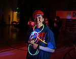 Triumph High School student Ajay Van Ortwick smiles and flashes peace signs during a portrait session at the school during a neon dance earlier this month. Van Ortwick listed parties, school dances and Frontier Days as her favorites things about living in Laramie County. Michael Smith/staff
