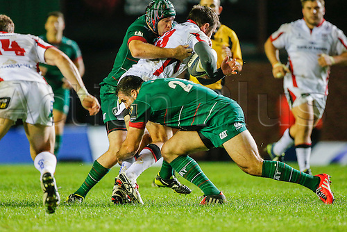 18.10.2014.  Leicester, England.  European Rugby Champions Cup. Leicester Tigers versus Ulster. Jared Payne of Ulster Rugby is tackled by Robert Barbieri (front) and Julian Salvi of Leicester Tigers.   Final score: Leicester Tigers 25-18 Ulster Rugby.