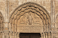 Christ in a mandorla, surrounded by the 4 symbols of the evangelists on the tympanum, on the lintel the 12 apostles and on the archivolts the 24 Elders of the Apocalypse, central bay of the Royal Portal, 1142-50, Western facade, Chartres cathedral, Eure-et-Loir, France. The central bay represents the End of Time as described by the Book of Revelations. Chartres cathedral was built 1194-1250 and is a fine example of Gothic architecture. It was declared a UNESCO World Heritage Site in 1979. Picture by Manuel Cohen