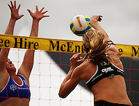 Susan Blundell spikes past Helke Classen at the net during the 2009 McEntee Hire NZ Beach Volleyball Tour - Women's final at Oriental Parade, Wellington, New Zealand on Sunday, 11 January 2009. Photo: Dave Lintott / lintottphoto.co.nz.