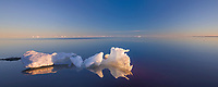 Iceberg floats in the Beaufort Sea off the shore of Barter Island, Kaktovik, Alaska