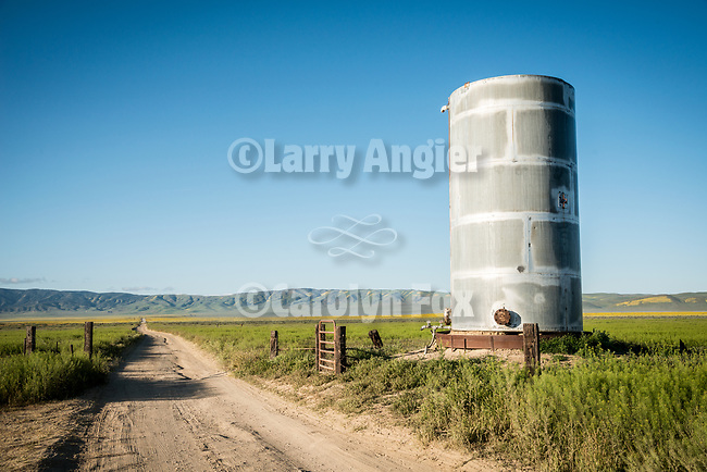 Metal water tank along a dirt road, Carrizo Plain National Monument