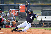 GCL Yankees 1 outfielder Leonardo Molina (18) slides home during the second game of a doubleheader against the GCL Braves on July 1, 2014 at the Yankees Minor League Complex in Tampa, Florida.  GCL Braves defeated the GCL Yankees 1 by a score of 3-1.  (Mike Janes/Four Seam Images)