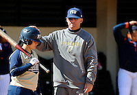 Florida International University Head Coach Jake Schumann and infielder Brie Rojas (24) during the game against the University of Illinois.  FIU won the game 8-0 on February 12, 2012 at Miami, Florida. .