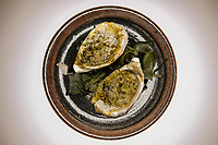 The dish of warm pacific oysters served with a herb and seaweed butter at a dinner featuring Will Studd and Philippe Mouchel at Philippe Restaurant in Melbourne, Australia on 12 September 2017. Photo Sydney Low