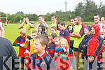 The Munster teams visit to Tralee Rugby club for an open training session on Friday which ran in conjunction with the Munster Rugby Summer Camp.  Pictured are the summer camp participants and the Munster players after playing a game together.