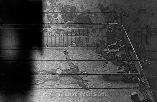 Ultimate Warrior vs. Kamala, WWF wrestling action. (solarized)<br />