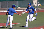 Wildcats Coach Ryan Gonzalez congratulates DJ Peters after he hit a solo home run in a college baseball game at Western Nevada College in Carson City, Nev., on Thursday, March 5, 2015. <br /> Photo by Cathleen Allison/Nevada Photo Source