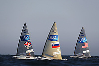RIO DE JANEIRO, BRAZIL - AUGUST 14:  Giles Scott of Great Britain, Vasilij Zbogar of Slovenia and Caleb Paine of the United States compete in the Men's Finn class on Day 9 of the Rio 2016 Olympic Games at the Marina da Gloria on August 14, 2016 in Rio de Janeiro, Brazil.  (Photo by Clive Mason/Getty Images)
