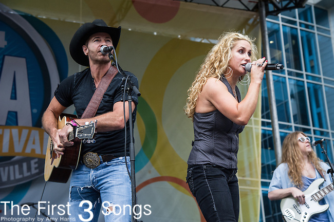 Keith Burns and Heidi Newfield of Trick Pony performs on Day One of the 2014 CMA Music Festival in Nashville, Tennessee.