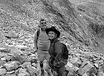 Jeanne Adams and Michael Adams Ansel&rsquo;s son look up at Mount Ansel Adams summit.<br /> <br /> In August of 1987, the family and friends of Ansel Adams made a trip to Mount Ansel Adams to honor Ansel by putting his ashes on the mountain.  Leading the trip were Dr. Michael Adams and his wife, Jeanne, their son, Matthew, and daughter, Sarah.  Also in the group were Ansel&rsquo;s daughter, Anne Adams Helms, and her husband, Ken Helms, and Anne's daughters, Virginia (Ginny) Mayhew and Sylvia Mayhew Desin, and Sylvia&rsquo;s husband, Greg Desin.  Other members of the trip were Roger and Mitzi Hall, Matt Weston, Mrs. Desin (Greg&rsquo;s mother), and Billy Butler.  The Adams family invited me along with Leo Stutzin (Modesto Bee reporter) and my eldest son, Aaron Golub.  <br /> <br /> With some of us on horseback and others on foot, we began the hike at Tuolumne High Sierra Camp and headed to Vogelsang High Sierra Camp for the first night out.  The second day, we began by climbing through Vogelsang Pass, then descended by switchback down to Lewis Creek.  After climbing up from the creek we hiked by the Cony Crags before descending into the Lyell Fork of the Merced River ending up near Hutchings Creek at what is now referred to as the Ansel Adams Camp.  <br /> <br /> This camp was originally known generically as a Sierra Club Camp, but has more recently been referred to as Ansel Adams Camp because in 1934, Ansel led a Sierra Club outing to the Lyell Fork of the Merced River.  After the group climbed the then-unnamed peak that Adams called &ldquo;The Tower in Lyell Fork,&quot; they gathered around the campfire and agreed that the peak should bear Ansel&rsquo;s name.  The U.S. Geological Survey does not, however, permit naming features for living individuals, so the peak did not officially become Mt. Ansel Adams until 1985, one year and one day after his death.  Photo by Al Golub/Golub Photography