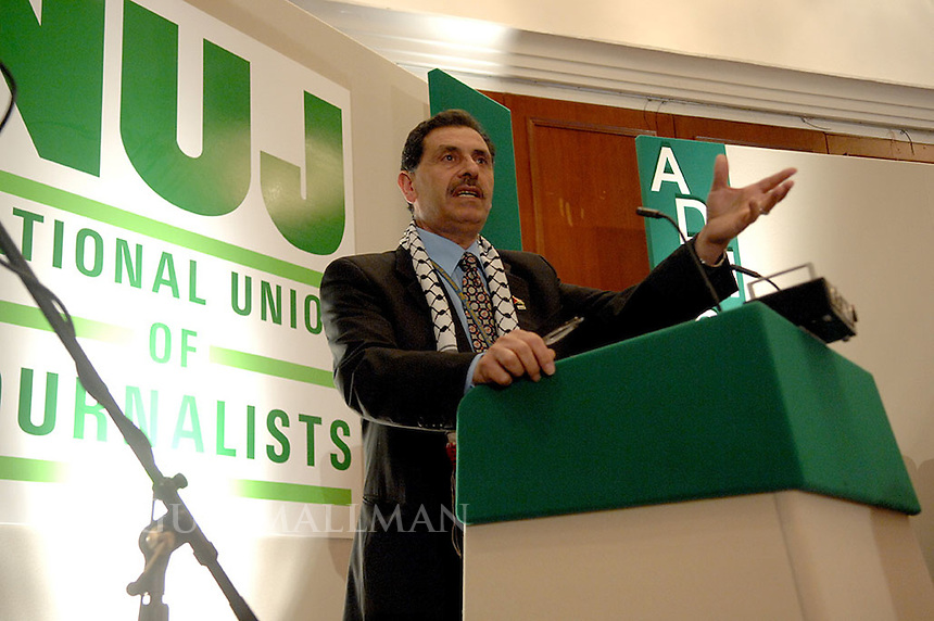 Naem Toubassi addresses the annual delegates meeting of the National Union of Journalists. Naem is the President of the Palestian Journalists Syndicate which was instrumental in the release of Alan Johnston the BBC jornalist who was imprisoned in Gaza in 2007. Also on the platform was Alan Johnston, NUJ General Sevretary Jeremy dear, NUJ President Michelle Stanistreet and Jim Boumella.