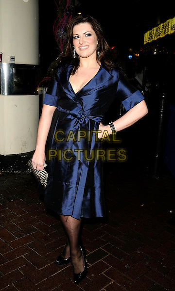"JODIE PRENGER .At the After Party for ""Clubbed"" Gala Screening at Ruby Blue in Leicester Square, London, England,.January 7th 2009..full length blue dress hand on hip wrap silk sash belted black shoes clutch bag purse  .CAP/CAN.©Can Nguyen/Capital Pictures"