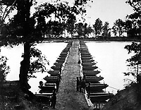 Lower pontoon bridge.  Deep Bottom, James River.  Attributed to Capt. Andrew J. Russell.  (War Dept.)<br /> Exact Date Shot Unknown<br /> NARA FILE #:  165-WHC-115<br /> WAR &amp; CONFLICT BOOK #:  207