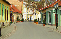 The Tokaj village: the main street with its colourful houses in blue yellow red and street light lamp posts. The small village called Tokaj is where the two rivers Bodrog and Tisza joins. It is much visited by tourists. the centre has been beautifully restored. Credit Per Karlsson BKWine.com