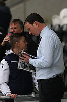 Ross County Manager Derek Adams signs autographs before the St Mirren v Ross County Scottish Professional Football League Premiership match played at St Mirren Park, Paisley on 3.5.14.