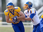 BROOKINGS, SD - APRIL 26:  Kyle Paris #32 from South Dakota State's offense takes a hand off from quarterback Tyler Finnes #11 during their spring game Saturday at Coughlin Alumni Stadium in Brookings. (Photo by Dave Eggen/Inertia)