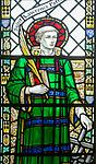 Stained glass window of Saint Lawrence, Knodishall church, Suffolk, England, UK UK by AK Nicholson 1930s