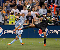 Graham Zusi, Leonardo Gonzalez. Sporting Kansas City won the Lamar Hunt U.S. Open Cup on penalty kicks after tying the Seattle Sounders in overtime at Livestrong Sporting Park in Kansas City, Kansas.