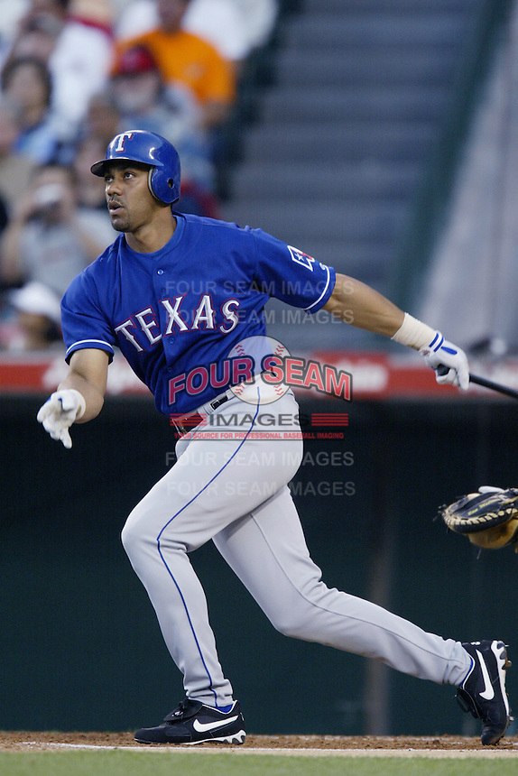 Juan Gonzalez of the Texas Rangers bats during a 2002 MLB season game against the Los Angeles Angels at Angel Stadium, in Los Angeles, California. (Larry Goren/Four Seam Images)