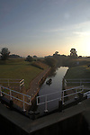Early morning boat on the river Ure after passing through locks, Boroughbridge, North Yorkshire, England.