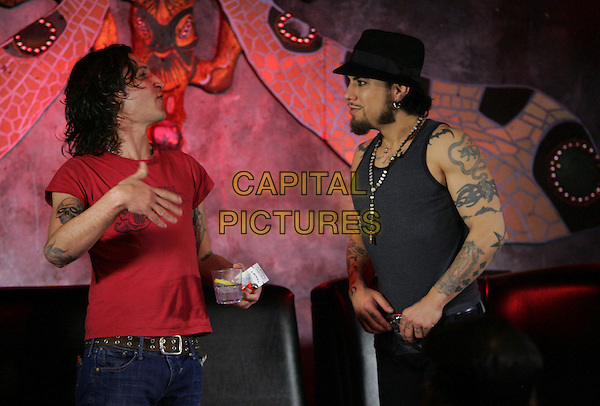 MICKEY AVALON & DAVE NAVARRO.Dave Navarro's live weekly internet show on Maniatv.com held at The Dragonfly in Hollywood, California, USA on Dave's Birthday.June 7th, 2007.half length profile drink beverage cigarette black hat top red tattoos                                                .CAP/DVS.©Debbie VanStory/Capital Pictures