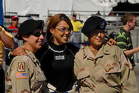 Apr 9, 2006; Las Vegas, NV, USA; NHRA Top Fuel dragster driver Hillary Will takes a photo with female U.S. Army soldiers prior to elimination at the Summitracing.com Nationals at Las Vegas Motor Speedway in Las Vegas, NV. Mandatory Credit: Mark J. Rebilas