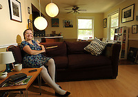 NWA Media/ANDY SHUPE - Photographer and teacher Sabine Schmidt's favorite spot is the living room of her Fayetteville apartment. Monday, June 30, 2014.