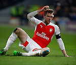 Per Mertesacker of Arsenal seems dazed moments before going off injured - English FA Cup - Hull City vs Arsenal - The KC Stadium - Hull - England - 8th March 2016 - Picture Simon Bellis/Sportimage