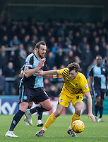 Ollie Clarke of Bristol Rovers holds off Paul Hayes of Wycombe Wanderers during the Sky Bet League 2 match between Wycombe Wanderers and Bristol Rovers at Adams Park, High Wycombe, England on 27 February 2016. Photo by Andy Rowland.