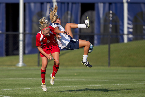 Notre Dame forward Adriana Leon (#19), up in the air, and Wisconsin defender Lauren Reid (#5) battle for loose ball in action during NCAA Women's soccer match between Wisconsin and Notre Dame.  The Notre Dame Fighting Irish defeated the Wisconsin Badgers 2-0 in match at Alumni Field in South Bend, Indiana.