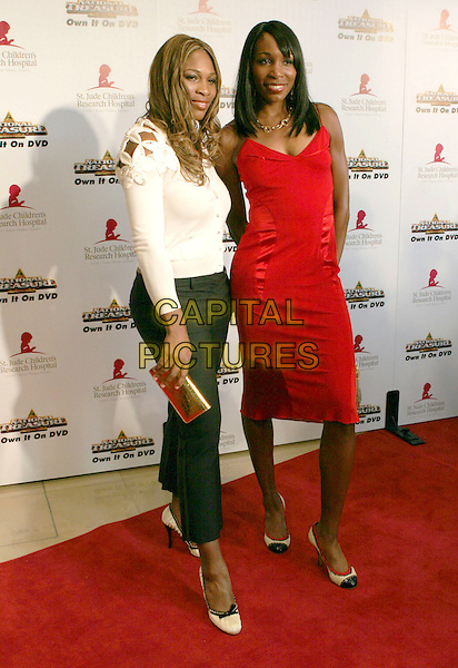 "SERENA WILLIAMS & VENUS WILLIAMS.3rd Annual Runway for Life Benefitting St. Jude Children's Research Hospital and Celebrating the DVD Release of ""National Treasure"" held at the Beverly Hilton Hotel, Beverly Hills, California, USA, 01st May 2005. .full length white cardigan flowers red dress louis vuitton satin round toe shoes black bow.Ref: ADM.www.capitalpictures.com.sales@capitalpictures.com.©Zach Lipp/AdMedia/Capital Pictures."