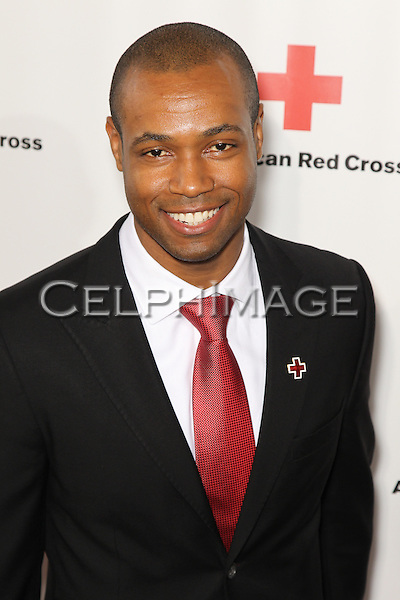 "ISAIAH MUSTAFA. Red carpet arrivals to the annual ""Red Tie Affair,"" benefitting the American Red Cross of Santa Monica, and honoring the humanitarian spirit of those who have shown courage, unselfish character and whose work has saved lives. At the Fairmont Miramar. Santa Monica, CA, USA. April 17, 2010."