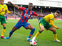 Crystal Palace Wilfried Zaha and Norwich City Emiliano Buendia during the Premier League match between Crystal Palace and Norwich City at Selhurst Park, London, England on 28 September 2019. Photo by Andrew Aleksiejczuk / PRiME Media Images.