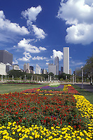 Chicago, Illinois, A cluster of (purple, yellow) flowers adorn Grant Park with the skyline of downtown Chicago in the background.