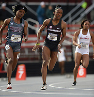 NWA Democrat-Gazette/ANDY SHUPE<br /> Arkansas' Janeek Brown (center) competes Thursday, May 9, 2019, in the 200 meters during the SEC Outdoor Track and Field Championships at John McDonnell Field in Fayetteville. Visit nwadg.com/photos to see more photographs from the meet.