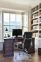 A stylish mix of traditional and modern furniture in a light-filled home office room.