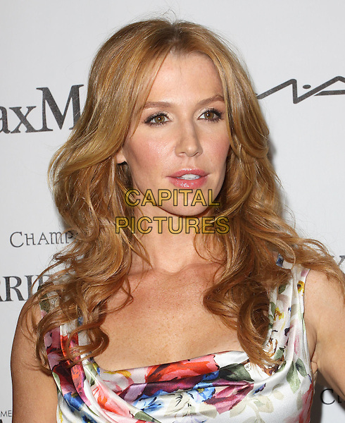 POPPY MONTGOMERY.3rd Annual Women In Film Pre-Oscar Party held At A Private Residence, Bel Air, California, USA..March 4th, 2010.headshot portrait sleeveless floral red white blue print flower ruched silk satin.CAP/ADM/KB.©Kevan Brooks/AdMedia/Capital Pictures.