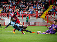 Goalkeeper Freddie Woodman of Crawley Town comes out and saves at the feet of Jason Banton of Wycombe Wanderers to save the day during the Sky Bet League 2 match between Crawley Town and Wycombe Wanderers at Checkatrade.com Stadium, Crawley, England on 29 August 2015. Photo by Liam McAvoy.