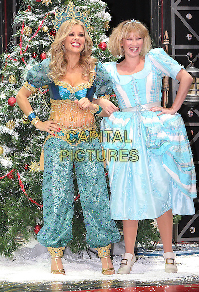 MELINDA MESSENGER & JOANNA PAGE .First Family Entertainment 2011 Pantomimes Photocall at the Piccadilly Theatre, London, November 26th 2010..panto costume full length genie blue turquoise beaded bra top trousers harem tassels midriff tummy stomach crop cropped cinderella dress hands on hips  .CAP/JIL.©Jill Mayhew/Capital Pictures