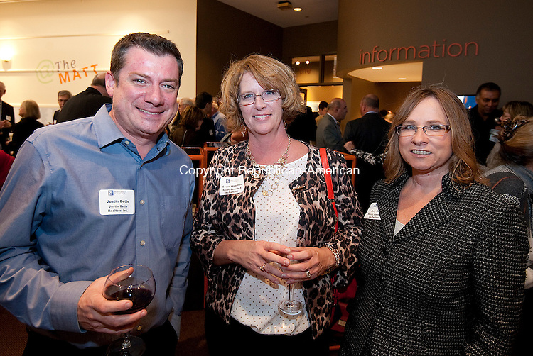 WATERBURY, CT--- -111815JS20--Justin Bette with Joseph Bete Realtor, left, with Susan Woodfield and Amy Smith, both with Secor, Cassidy &amp; McPartland at the 150th anniversary celebration for the law firm of Secor, Cassidy &amp; McPartland at the Mattatuck Museum in Waterbury. <br />  Jim Shannon Republican-American