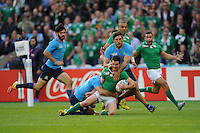 Johnny Sexton of Ireland is tackled by Giovanbattista Venditti and Leonardo Sarto of Italy during Match 28 of the Rugby World Cup 2015 between Ireland and Italy - 04/10/2015 - Queen Elizabeth Olympic Park, London<br /> Mandatory Credit: Rob Munro/Stewart Communications
