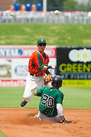 Blake Barber (8) of the Greensboro Grasshoppers throws to first to complete a double play as Chuckie Jones (20) of the Augusta GreenJackets slides into second base at NewBridge Bank Park on August 11, 2013 in Greensboro, North Carolina.  The GreenJackets defeated the Grasshoppers 6-5 in game one of a double-header.  (Brian Westerholt/Four Seam Images)